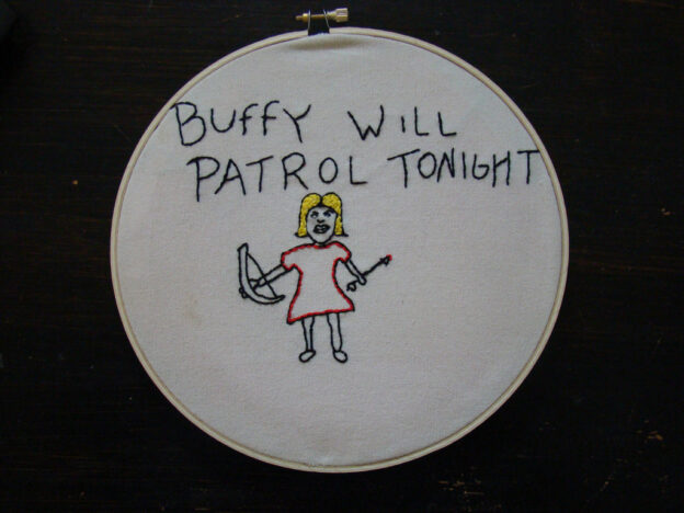 """Embroidery showing stick-figure Buffy with crossbow and arrow that reads """"Buffy will patrol tonight"""""""